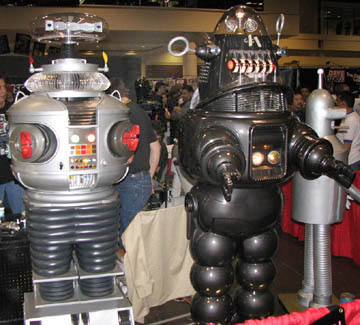 "On left, B-9 Robot from ""Lost In Space"", right, Robby The Robot from ""Forbidden Planet"""